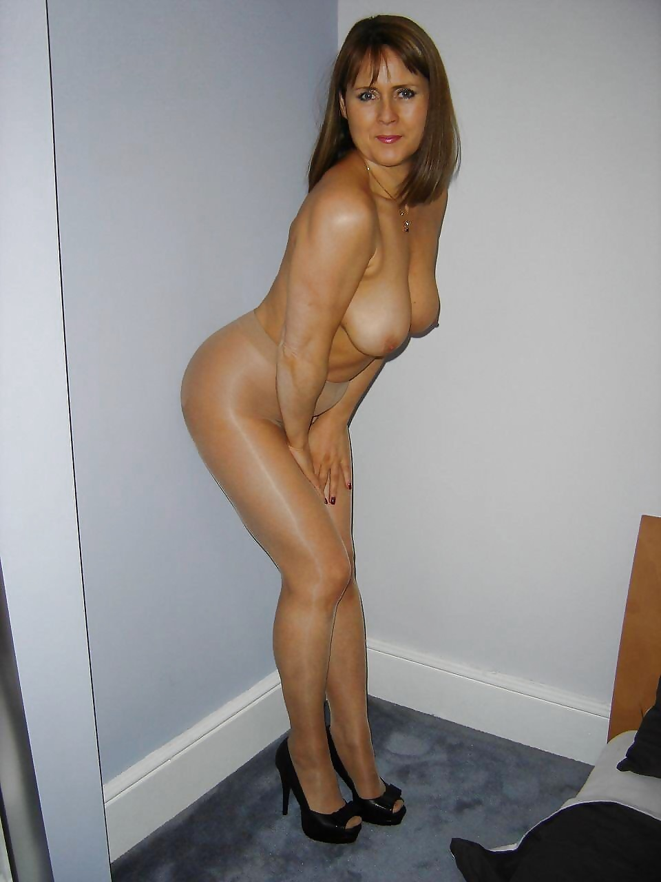 Check my milf in black opaque stockings and boots 5